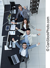 top view. happy business team sitting at the Desk