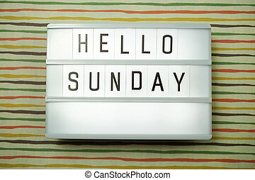 Top view Happy Sunday Text in Light box flat lay