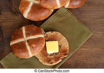 top view hot cross bun with butter