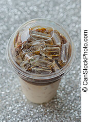 Iced coffee - top view Iced coffee in plastic cup for take...