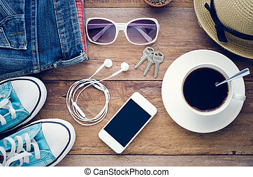 top view image of smartphone with blank screen headphones coffee cup and costome on wooden floor