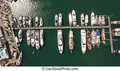 Top view marina aerial yacht business boat harbor luxury tourism coastline travel drone shotting Bodrum Mugla, Turkey