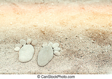 maritime background with feet made of stones on sand background