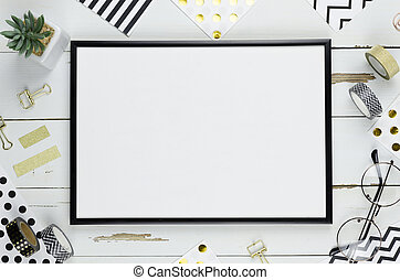 Top view mockup white table with black frame arranged with black and white stationery with copy space