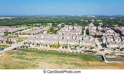 Top view new development riverside residential and commercial neighborhood with vacant land in Texas, USA