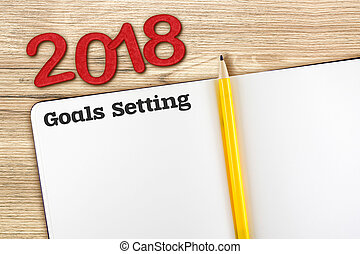 Top view of 2018 new year red number and goals setting with...