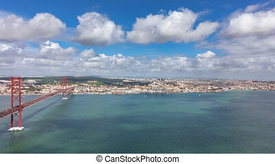 Top view of 25 de Abril Bridge and Belem district in Lisbon...