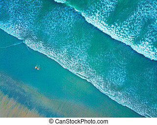 Top view of a beautiful beach with people in Thailand