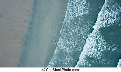 Top view of a beautiful beach with people in Thailand. Green...