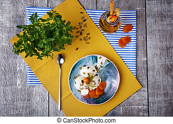 Top view of a beautiful brunch. Vanilla ice cream with fruits. Dessert and jar of apricot drink on a wooden background.