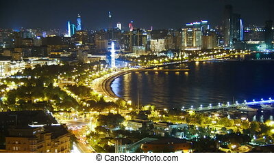 Top View of a Big City by the Sea at Night. Baku, Azerbaijan. Time Lapse