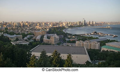 Top View of a Big City by the Sea. Day to Night. Baku, Azerbaijan. Time Lapse
