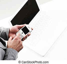 top view of a businesman's hands with a smart phone