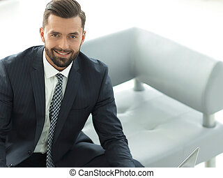 businessman working on a laptop with financial charts