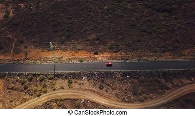 Top view of a car rides along a desert road on Tenerife, Canary Islands, Spain. Timelapse