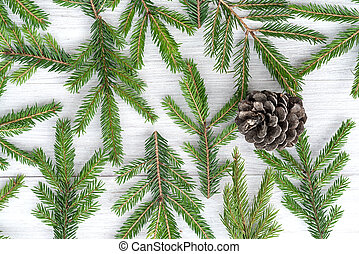Top view of a Christmas wooden background made of fir branches