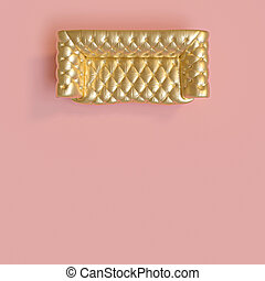 top view of a classic gold-colored tufted sofa on a pink background.