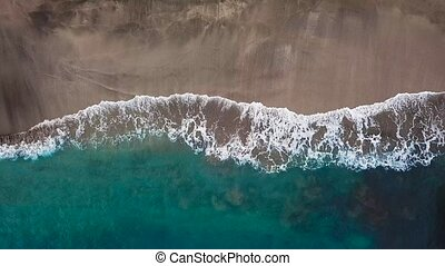 Top view of a deserted black volcanic beach. Coast of the...