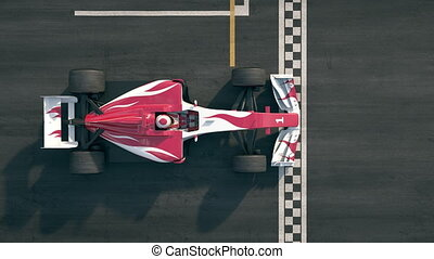 Top view of a formula one race car driving over finish line in slow motion