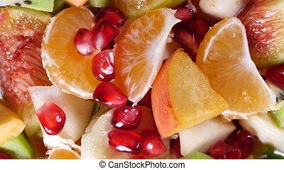 Top view of a fruit salad with mandarin, oranges, kiwi,...