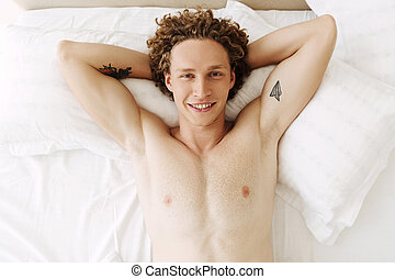 Top view of a handsome young man with curly hair