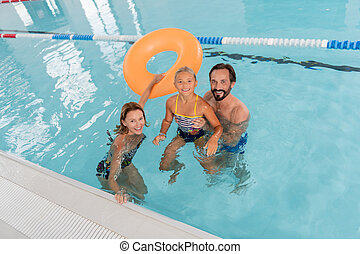Top view of a happy family in the pool