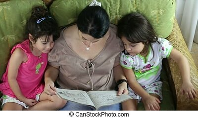 Top view of a happy family reading