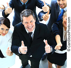 Top view of a happy team of business colleagues gesturing a ...