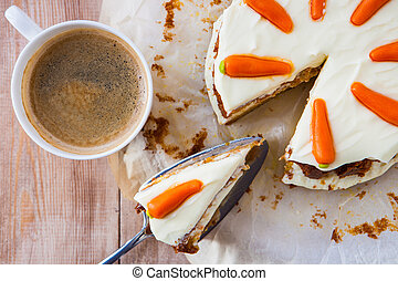 Top view of a homemade carrot cake with mascarpone cream cheese