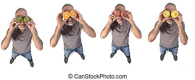 top view of a man with fruits in his eyes