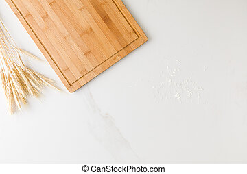 Top view of a marble table with a wooden board, wheat and flour with space for text (2)