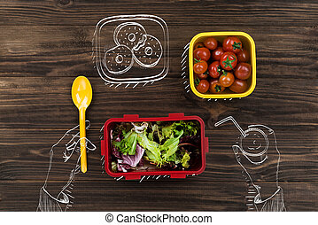 Top view of a person eating fresh vegetables