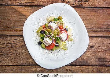 Top view of a plate with vegetable salad