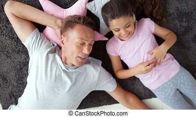 Top view of a pleasant handsome man resting with his daughter