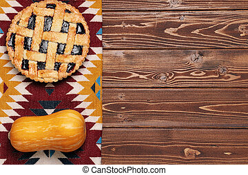 Top view of a thanksgiving pie on brown wooden table