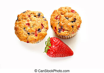 Top View of a Whole Strawberry and Berry Muffins