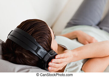 Top view of a woman listening to music