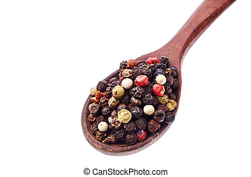 Top view of a wooden spoon full of allspice seeds isolated on white background, shallow depth of field, front focus