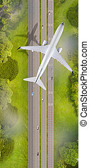 Top view of airplane flying over the roads