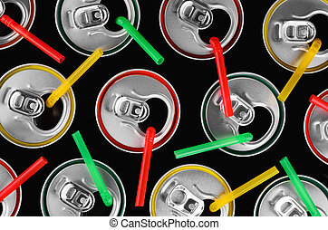 top view of aluminum cans with colorful straws and colorful stro