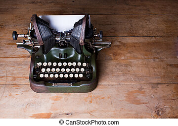 Top view of an old typewriter on a wooden table