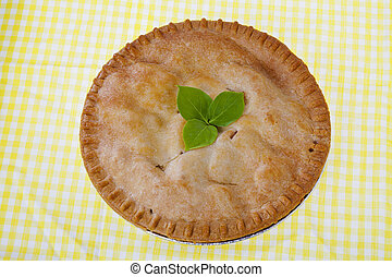 top view of apple pie with leaves