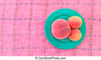 Top View of Apricots With Peach in a Plate