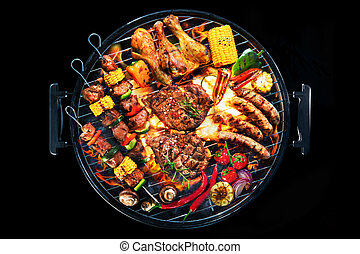 Top view of assorted delicious grilled meat with vegetables on barbecue isolated on black background