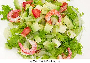 Top view of avocado salad with vegetables, mozzarella and shrimps