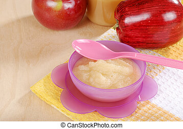 baby apple sauce food with spoon - top view of baby apple...