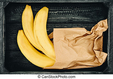 top view of bananas in shopping paper bag
