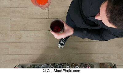 Top view of bartender mixing cocktail in shaker