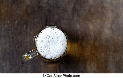 Top view of Beer in glass on the wooden table background