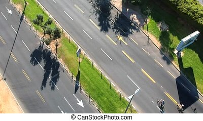 Top view of bicycle riders group on main road